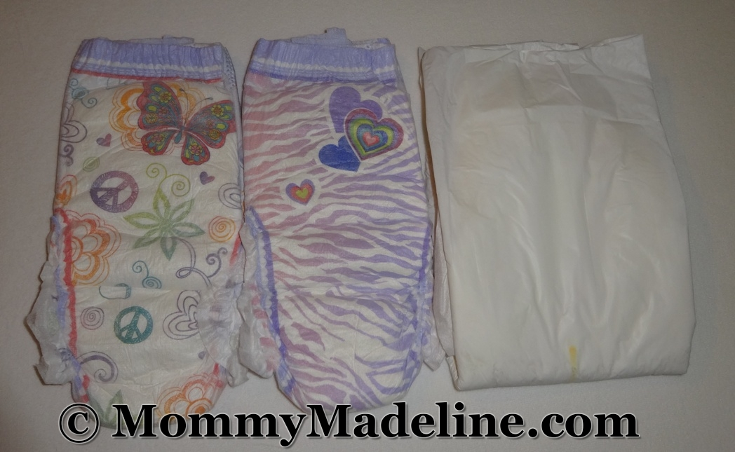 Colorful pull-up diapers next to a white one