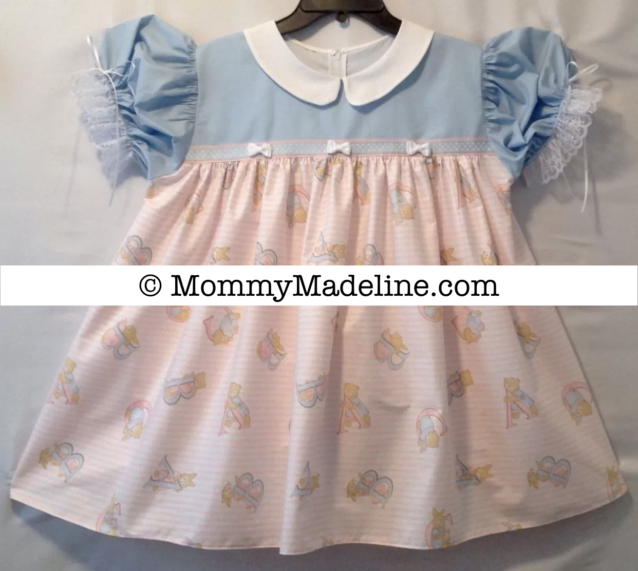 A lovely sissy baby dress with alphabet letters