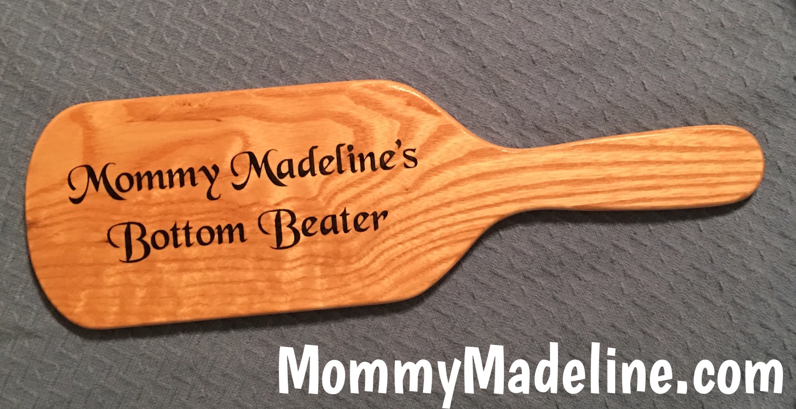 Mommy's Bottom Beater is a wooden paddle